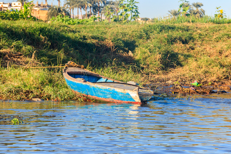 Old fishing rowing boat on the shore of Nile river, Egypt 写真素材