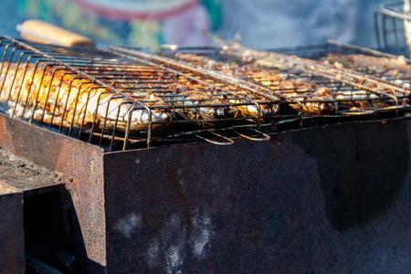 Mackerel cooking on the grill Archivio Fotografico