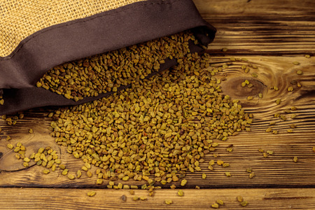 Fenugreek seeds on wooden table