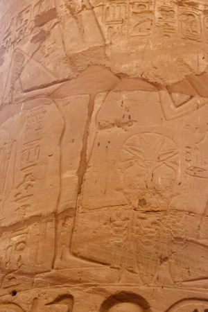 Ancient Egyptian fertility god Min carved on column in Great Hypostyle Hall in Karnak temple complex in Luxor, Egypt Stock Photo