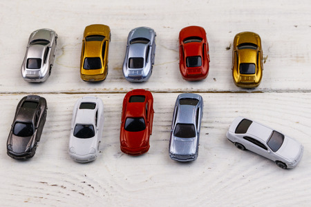 Cars toys on white wooden background Stock Photo