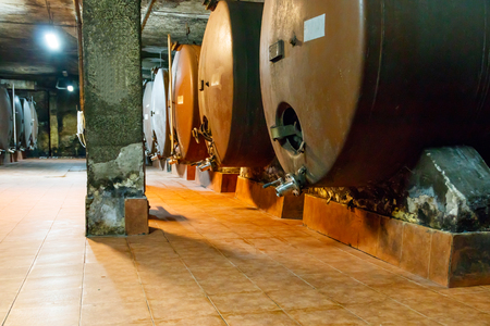 Large storage tanks where grape juice is aged into wine located in a wine cellar