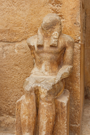 Old statue near pyramid temple in Giza, Cairo, Egypt