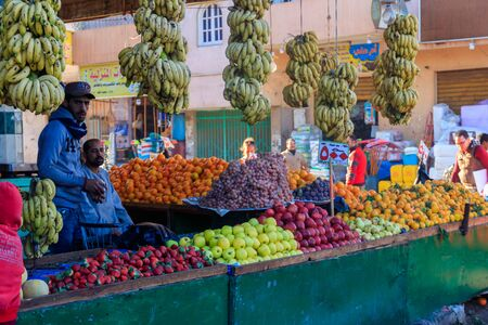 Hurghada, Egypt - December 9, 2018: Sellers and customers at local fruit market in Hurghada