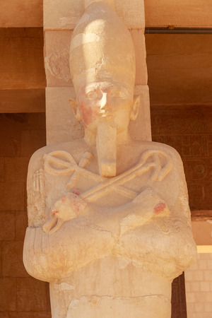 Statue of pharaoh in Mortuary Temple of Hatshepsut in Luxor, Egypt
