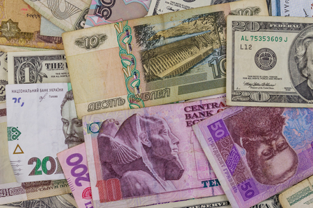 Multicurrency background of US dollars, Russian rubles, Belarusian rubles, Egyptian pounds and Ukrainian hryvnias