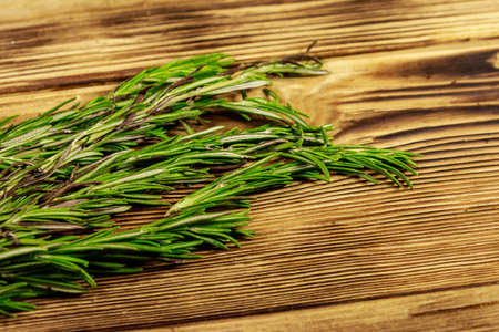 Fresh rosemary herbs on a wooden table