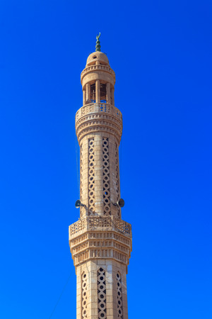 Minaret of mosque in Dahar neighborhood (old town of Hurghada) in Egypt