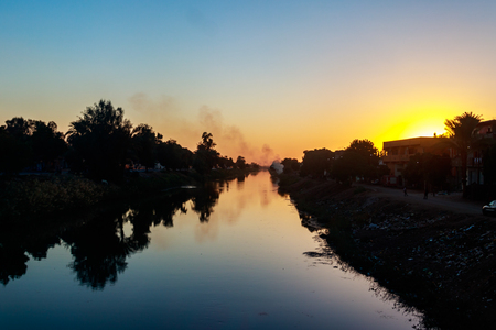 View of irrigation canal at sunset in Egypt
