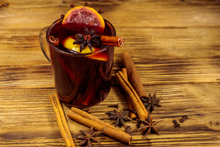 Mulled wine and spices on wooden table Stock Photo