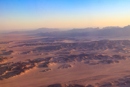 Aerial view of Arabian desert and mountain range Red Sea Hills near Hurghada, Egypt. View from airplane Stockfoto