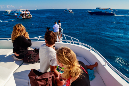 Young people on white yacht looking on Red sea Zdjęcie Seryjne