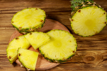 Fresh pineapple on wooden table Stock Photo