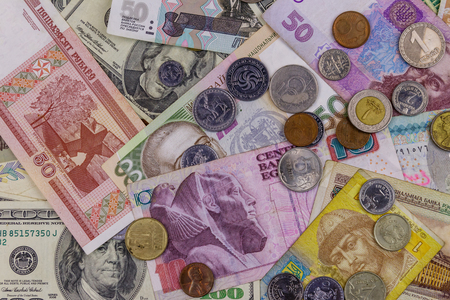 Background of banknotes and coins from different countries