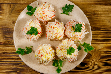 Appetizer of crab-cheese balls on wooden table. Top view