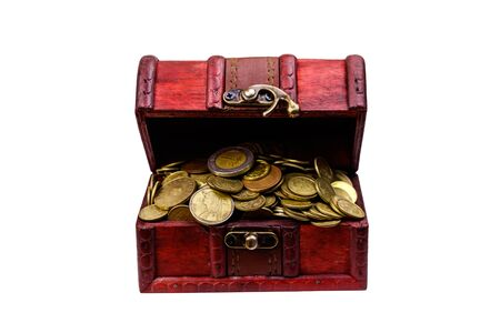 Vintage treasure chest full of golden coins isolated on white background Stock Photo