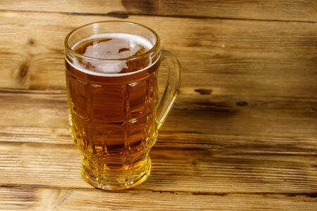Mug of beer on a wooden table