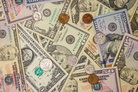 Background of different american dollars bills and coins Standard-Bild