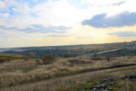 View on the bridge across the river Southern Bug in Ukraine on autumn Reklamní fotografie