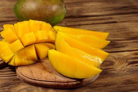 Fresh mango fruit on wooden table