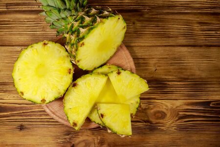 Fresh pineapple on wooden table. Top view Reklamní fotografie