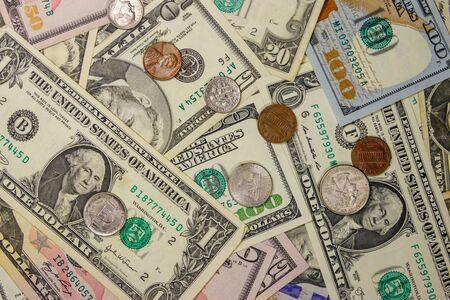 Background of different american dollars bills and coins 版權商用圖片