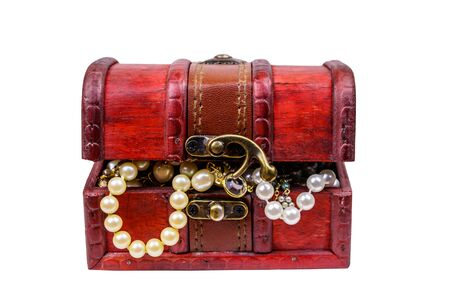 Vintage treasure chest full of jewelry and accessories isolated on white background