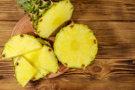 Fresh pineapple on wooden table. Top view Stock Photo