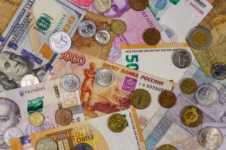 Background of banknotes and coins from different countries Reklamní fotografie
