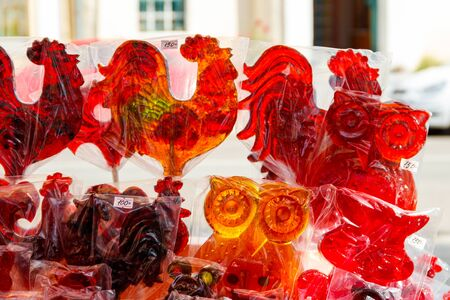 Rooster shaped lollipops for sale at street market. Traditional russian lollipops