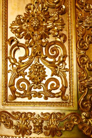 Close-up of a gilded ornate door