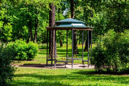 Wrought iron gazebo in a park at summer Фото со стока