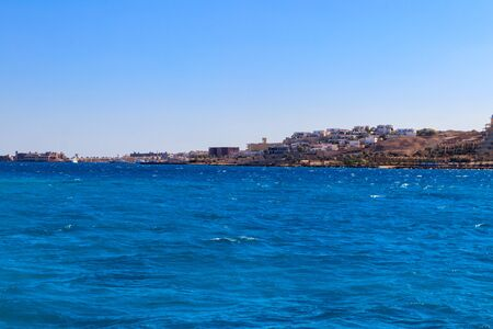 Beautiful view of the coastline with houses and hotels in Hurghada, Egypt. View from Red sea