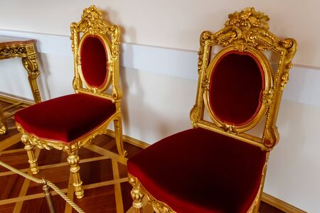 Red classical chairs in a room Stok Fotoğraf - 130446603