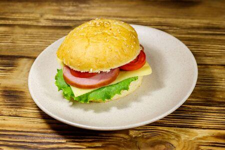 Fresh delicious homemade cheeseburger on a wooden table