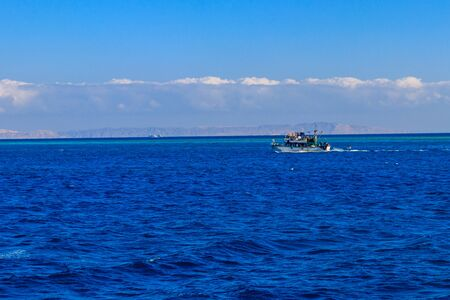 Fishing trawler sails at Red sea in Hurghada, Egypt