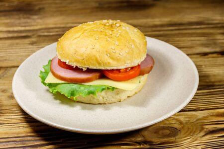 Fresh delicious homemade cheeseburger on a wooden table Stock fotó