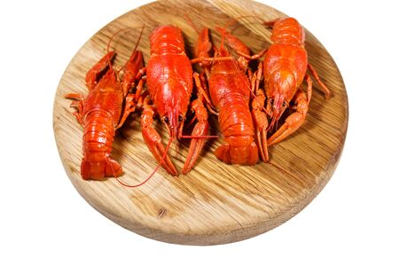Boiled crayfish on wooden cutting board isolated on white background Reklamní fotografie