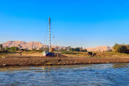 Old felucca boat ashore of Nile river in Egypt