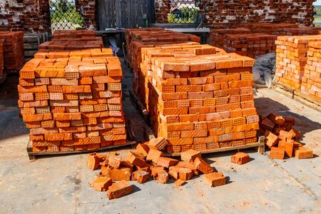 Stacks of new red brick at construction site