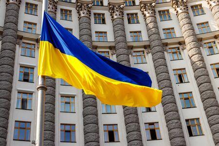 Flag of Ukraine against the Cabinet of Ministers of Ukraine building Reklamní fotografie