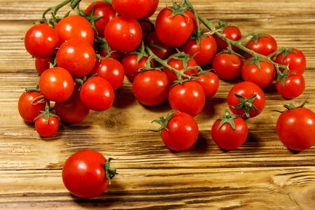 Fresh cherry tomatoes on a wooden table Stock Photo
