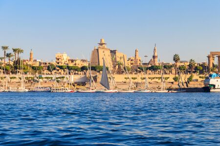 Luxor Temple is a large Ancient Egyptian temple complex on east bank of Nile river in Luxor (ancient Thebes). View from Nile river Banco de Imagens