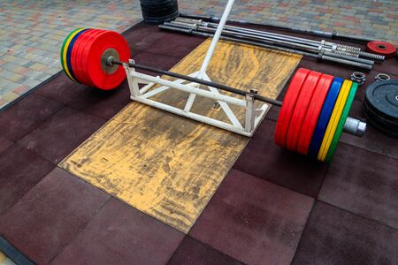Barbell on the floor in gym