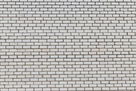 Texture of a white brick wall for background