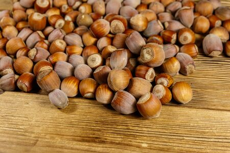 Heap of hazelnuts on a wooden table Stock Photo