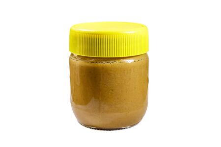 Jar of peanut butter isolated on white background