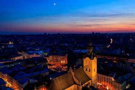 Aerial night view of illuminated Latin cathedral and Rynok square in Lviv, Ukraine. View from Lviv town hall