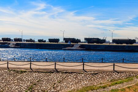 Military vehicles at a pier in Kronstadt, Russia