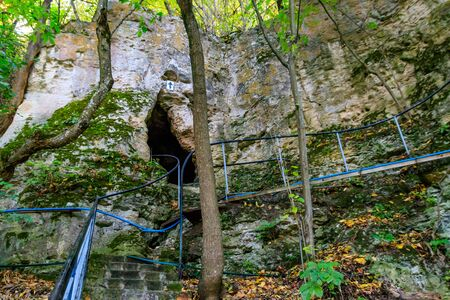 Galician Cave St. Nicholas Monastery located on a bank of the Dniester river in Halytsya village, Chernivtsi region, Ukraine Banco de Imagens